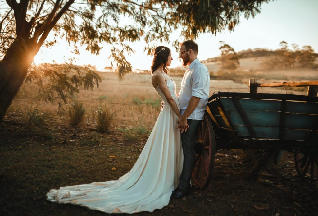 A bride and groom in nature at sunset