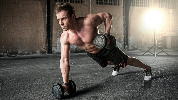 Man lifting weights on the floor